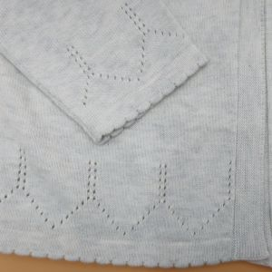intricate knit detail on baby clothes rental cardigan