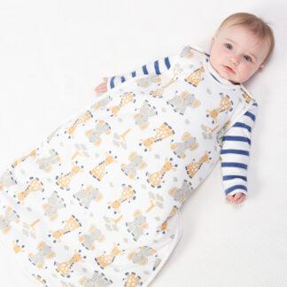 A baby in a giraffe and elephant sleep bag